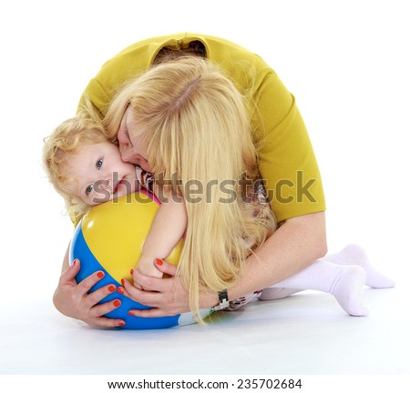 Adorable little girl tightly kisses and hugs her mom.White background, isolated photo. - stock photo