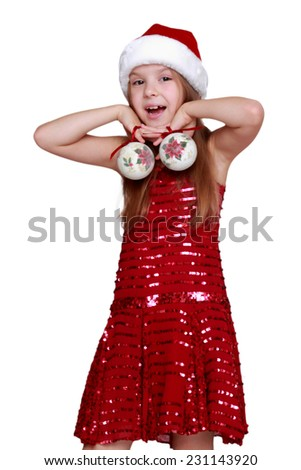 Adorable little girl wearing a Santa Hat and Dress on Holiday theme/Smiley little santa isolated on white on Christmas