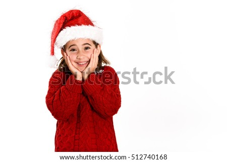 Adorable little girl wearing santa hat isolated on white background. Winter clothes for Christmas