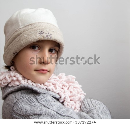 adorable little girl wearing winter hat
