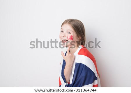 "Adorable little girl with a flag of Great Britain (British flag) and ""UK"" painted on her face - stock photo"