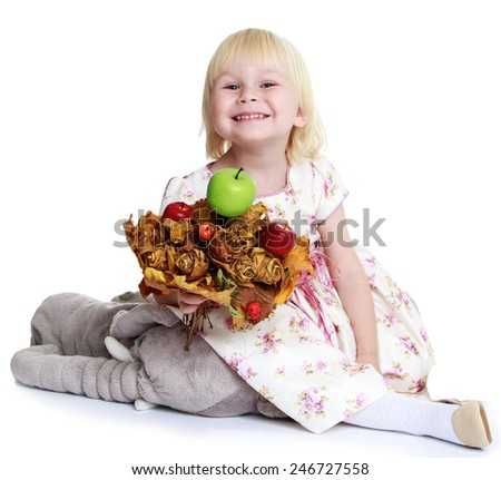 Adorable little girl with an apple.concept childhood education and child development.Isolated on white background - stock photo