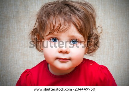 Adorable little girl with big blue eyes - stock photo