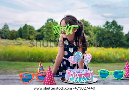 Adorable little girl with big Rock Star glasses on a birthday party, 9