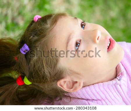 Adorable little girl with brown - stock photo