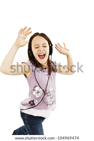 Adorable little girl with headphones. Isolated on white background. - stock photo