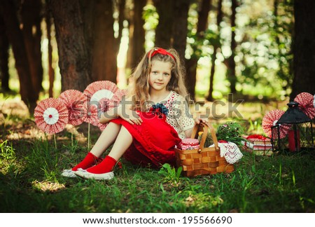 Adorable little girl with long blond hair outdoor - stock photo
