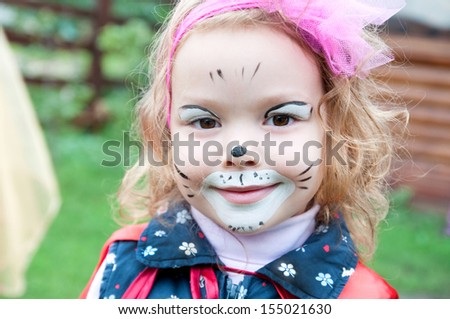 Adorable little girl with painted face, party - stock photo