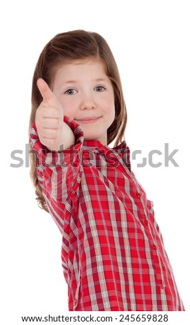 Adorable little girl with red plaid saying Ok shirt isolated on a white background