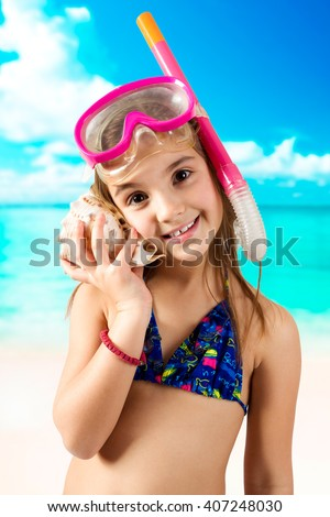 Adorable little girl with snorkeling equipment - stock photo