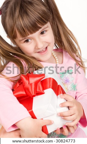 Adorable little girl with white gift box - stock photo