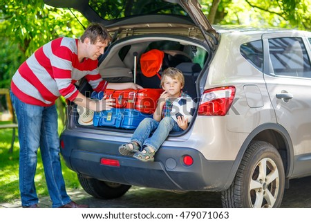 happy boy sitting in a suitcase stock images royalty free images vectors shutterstock. Black Bedroom Furniture Sets. Home Design Ideas