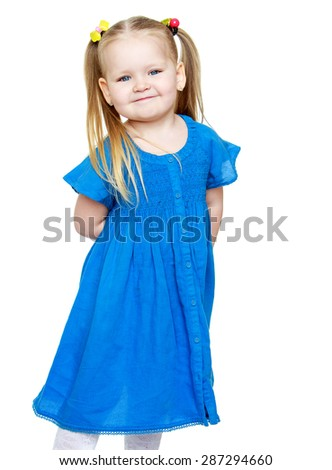 Adorable little round-faced girl with pigtails on her head and blue summer dress , close-up-Isolated on white background - stock photo
