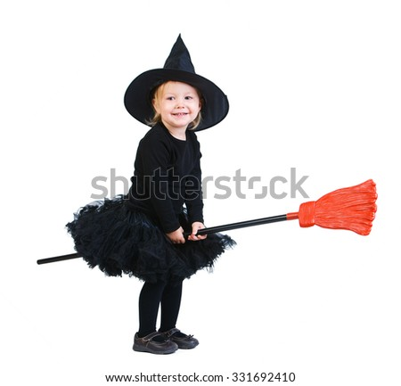 Adorable little witch flying on broomstick isolated on white - stock photo