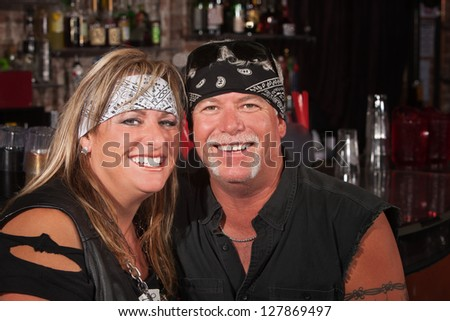 Adorable mature couple in motorcycle rider clothing