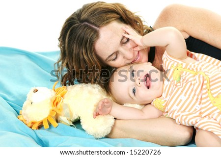 Adorable Mother and Child, playing together - stock photo
