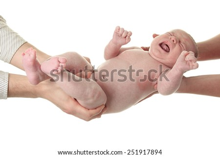 Adorable naked baby boy with blue eyes, lying on soft fur blanket - stock photo