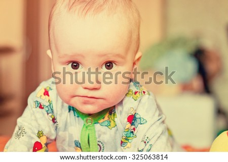 Adorable newborn baby boy funny portrait. Image with vintage filter - stock photo