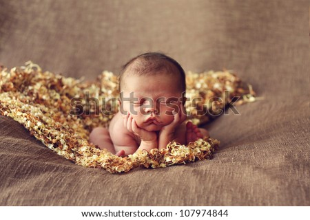 Adorable newborn baby boy on elbows - stock photo
