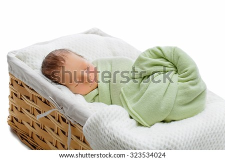 Adorable newborn baby boy sleeping in basket. Copy space. Horizontal composition. Isolated over white background. - stock photo