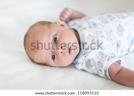 Adorable newborn baby boy with blue eyes