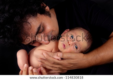 Adorable newborn baby boy with loving father - stock photo