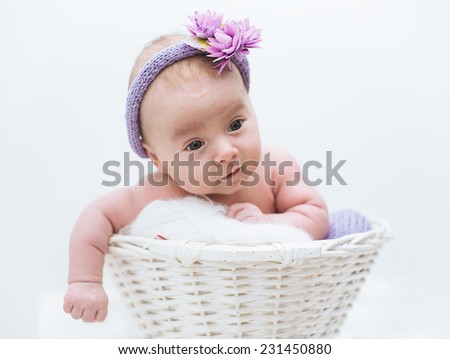 adorable  newborn baby girl in the basket - stock photo