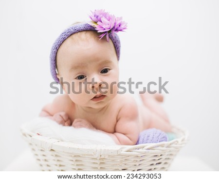 adorable newborn baby girl in the basket