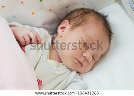 Adorable newborn baby girl portrait sleeping. - stock photo