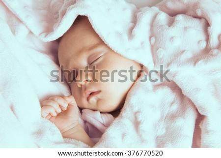 Adorable Newborn baby peacefully sleeping. Closeup Portrait. Studio shot, Horizontal - stock photo
