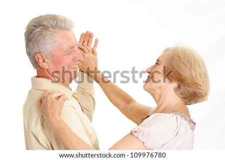 Adorable old couple on a white background - stock photo