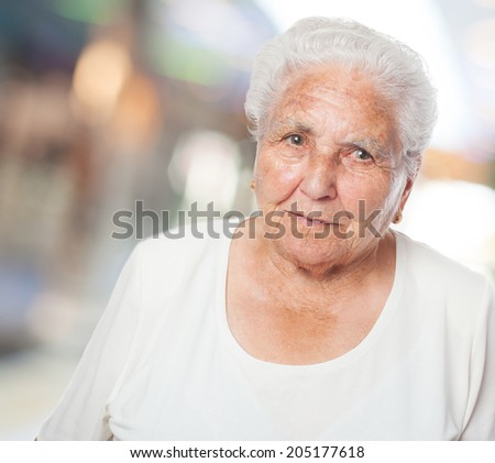 adorable old woman face closeup over abstract background