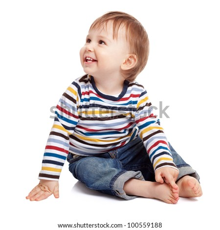 Adorable one year old child playing with his big toe and having a good time, isolated on white - stock photo