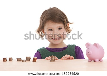 Adorable preschooler excited about all the money she has.  Isolated on white with room for your text.