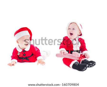 Adorable Santa babies - boy and girl isolated on white  - stock photo