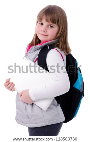 Adorable school girl with laptop - stock photo