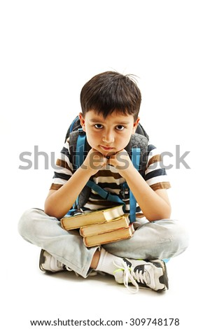 Adorable schoolboy. Isolated on a white background - stock photo