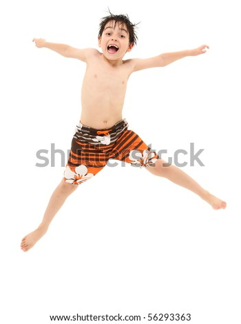 Adorable seven year old french american boy in swim suit and wet hair jumping excited about going swimming. - stock photo