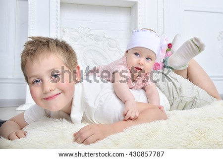 Adorable sister and brother portrait