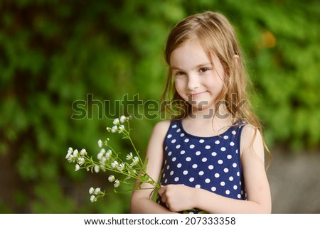 Adorable six years old girl on beautiful sunny day at summer - stock photo