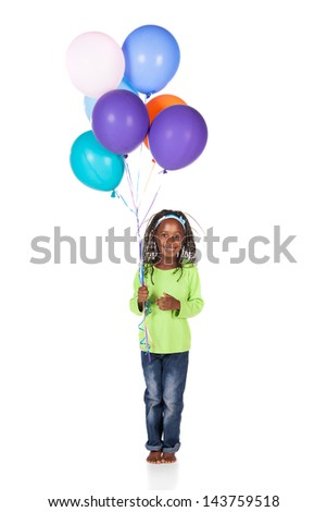 Adorable small african child with braids wearing a bright green shirt and blue jeans. The girl is holding a bunch of bright coloured helium balloons. - stock photo