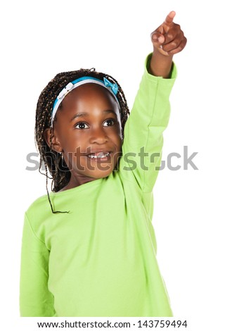 Adorable small african child with braids wearing a bright green shirt. The girl is pointing with her finger and looking away from the camera.