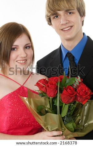 Adorable teen couple in formals with roses.  Prom, dance, Valentine's Day or Christmas. - stock photo