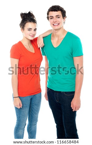 Adorable teenage couple in casuals isolated on white background