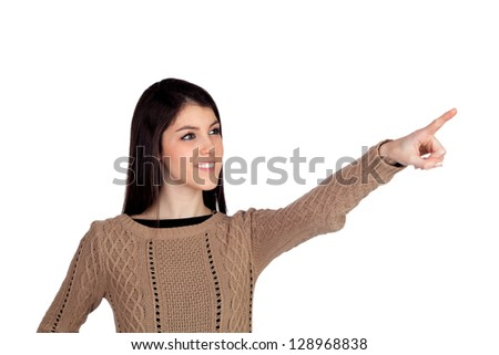Adorable teenager girl indicating something isolated on a white background - stock photo