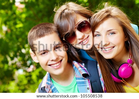 Adorable teenagers spending time outdoors in summer - stock photo
