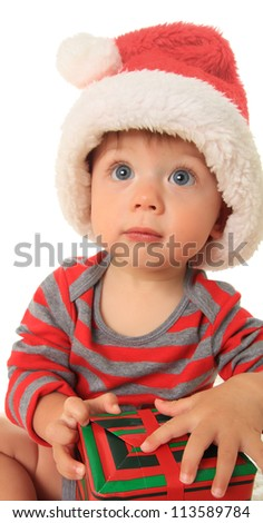 Adorable ten month old baby boy wearing a Santa hat. - stock photo