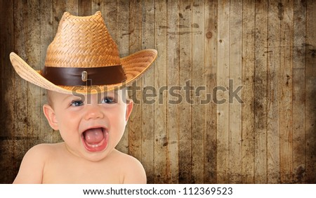 Adorable ten month old baby cowboy.