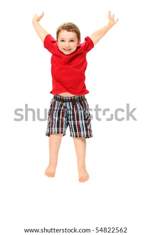 Adorable three year old boy jumping over white. - stock photo