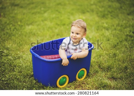 Adorable Toddler Baby boy playing and having Fun in the Garden - stock photo